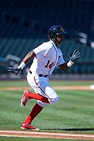 Mesa Solar Sox designated hitter Victor Robles (14), of the Washington Nationals organization, hustles down the first base line during an Arizona Fall League game against the Scottsdale Scorpions on October 24, 2017 at Sloan Park in Mesa, Arizona. The Scorpions defeated the Solar Sox 3-1. (Zachary Lucy/Four Seam Images)