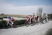 peloton with Arnaud Démare (FRA/FDJ) over the 'plugstreet Christmas Truce' gravel section. <br /> <br /> 81st Gent-Wevelgem in Flanders Fields (1.UWT)<br /> Deinze > Wevelgem (251km)