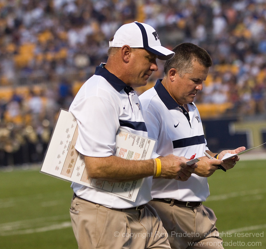 Pitt offensive line coach Spencer Leftwich and head coach Todd Graham. The Pittsburgh Panthers beat the Buffalo Bulls 35-16 at Heinz field in Pittsburgh, Pennsylvania on September 3, 2011