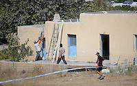Pictured: A worker uses a cutting disc to cut through the walls of the building before a digger moves in to demolish part of the house where Ben Needham disappeared from in Kos, Greece. Tuesday 04 October 2016<br /> Re: Police teams led by South Yorkshire Police, searching for missing toddler Ben Needham on the Greek island of Kos have moved to a new area in the field they are searching.<br /> Ben, from Sheffield, was 21 months old when he disappeared on 24 July 1991 during a family holiday.<br /> Digging has begun at a new site after a fresh line of inquiry suggested he could have been crushed by a digger.