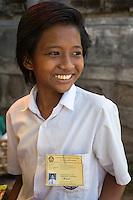 Bali, Indonesia.   Teenage Schoolgirl.  Tenganan Village.