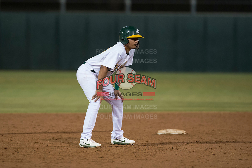 AZL Athletics first baseman Christopher Quintin (18) during an Arizona League game against the AZL Giants Orange at Lew Wolff Training Complex on June 25, 2018 in Mesa, Arizona. AZL Giants Orange defeated the AZL Athletics 7-5. (Zachary Lucy/Four Seam Images)