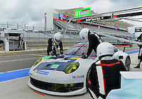 September 19, 2013: <br /> <br /> Pit crew of Jorg Bergmeister (DEU) \ Patrick Pilet (FRA) \ of Porsche Ag Team Manthey driving #91 LMGTE Pro Porsche 911 RSR during International Sports Car Weekend test and setup session at Circuit of the Americas in Austin, TX.