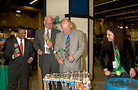 March 19 2003, Montreal, Quebec, Canada<br /> <br /> (fron Left to Right)<br />  Alan  De Sousa, City of Montreal delegate for sustainable Development<br /> David Anderson,Canada's  Environment Minister,, Andre Caille, President and CEO of Hydro Quebec and Honorary President of AMERICANA 2003,join the SCRAP BAND  to celebrate the opening  of Americana, a 3 days  trade show on environement and waste management organized by Reseau Environnement, March 19, 2003 in Montreal, Canada.<br /> <br /> Photo :   Pierre Roussel / AGENCE QUEBEC PRESSE<br /> .Uncompressed  Original  size  file availble on request.