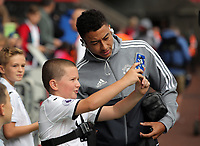 Jesse Lingard of Manchester United has a selfie taken by a young supporter during the English Premier League soccer match between Swansea City and Manchester United at Liberty Stadium, Swansea, Wales, UK. Saturday 18 August 2017