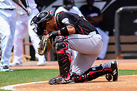 Lansing Lugnuts catcher Javier Hernandez (29) writes in the dirst behind home plate during a Midwest League game against the Wisconsin Timber Rattlers on May 8, 2018 at Fox Cities Stadium in Appleton, Wisconsin. Lansing defeated Wisconsin 11-4. (Brad Krause/Four Seam Images)