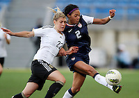 USA's Sydney Leroux fights for the ball with Germany's Luisa Wensing during their Algarve Women's Cup soccer match at Algarve stadium in Faro, March 13, 2013.  .