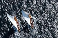Match Race:EUROPA, DEUTSCHLAND, SCHLESWIG- HOLSTEIN 22.06.2005: Matchrace, 12er Yachten hart am Wind in der Kieler Förde. Diese beiden Schiffe zeigen in ihrem Match Race die klassische Rumpfform. Die linke Yacht mit dem Segelkennzeichen K10 hat die rechte Yacht mit dem Segelkennzeichen D1 im Lee überholt. Trivia, Thea, <br /> Luftaufnahme, Luftbild,  Luftansicht