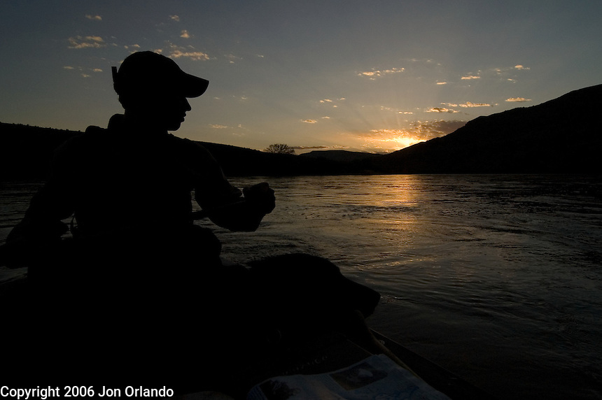 Dave Gentempo and his dog enjoy the sunset in Horsethief Canyon on the Colorado River in western Colorado.