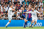 Sergio Busquets Burgos (c) of FC Barcelona competes for the ball with Lucas Vazquez (l) and Daniel Carvajal Ramos of Real Madrid during their Supercopa de Espana Final 2nd Leg match between Real Madrid and FC Barcelona at the Estadio Santiago Bernabeu on 16 August 2017 in Madrid, Spain. Photo by Diego Gonzalez Souto / Power Sport Images