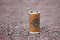 A Charleston RiverDogs branded bat weight sits on the ground during the Low-A East Championship game against the Down East Wood Ducks at Joseph P. Riley, Jr. Park on September 26, 2021 in Charleston, South Carolina. (Brian Westerholt/Four Seam Images)