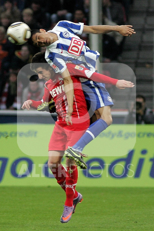 03.04.2010,  Rhein Energie Stadion, Koeln, GER, 1.FBL, FC Koeln vs Hertha BSC Berlin, 29. Spieltag, im Bild:  Cicero (Berlin #7) Kopfball Zoran Tosic (Koeln #14)  Foto © nph / Mueller..