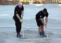 Pictured: Detective Inspector of South Yorkshire Police (L) helps sift through soil in Kos, Greece. Thursday 06 October 2016<br />Re: Police teams led by South Yorkshire Police, searching for missing toddler Ben Needham on the Greek island of Kos have moved to a new area in the field they are searching.<br />Ben, from Sheffield, was 21 months old when he disappeared on 24 July 1991 during a family holiday.<br />Digging has begun at a new site after a fresh line of inquiry suggested he could have been crushed by a digger.