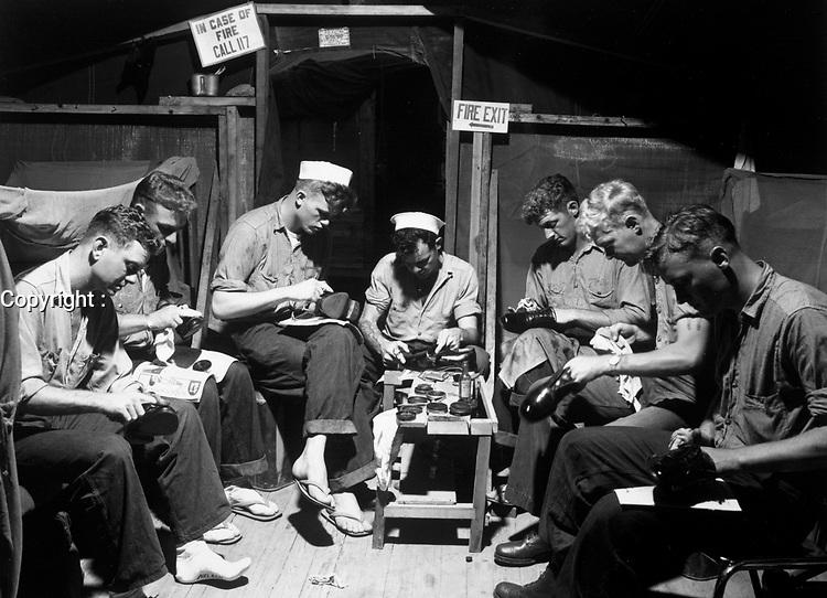 Men at Munsan-ni, preparing for inspection prior to acting as honor guard at signing of armistice at Panmunjom, Korea.  Navy men shining their shoes.  July 23, 1953. (Navy)<br /> NARA FILE #:  080-G-625791<br /> WAR & CONFLICT BOOK #:  1390