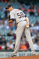 Detroit Tigers starting pitcher Doug Fister (58) glances over to first base while in the stretch during the MLB baseball game against the Houston Astros on May 3, 2013 at Minute Maid Park in Houston, Texas. Detroit defeated Houston 4-3. (Andrew Woolley/Four Seam Images).