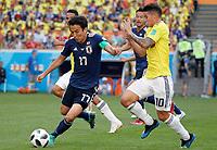 SARANSK - RUSIA, 19-06-2018: James RODRIGUEZ (Der) jugador de Colombia disputa el balón con Makoto HASEBE (Izq) jugador de Japón durante partido de la primera fase, Grupo H, por la Copa Mundial de la FIFA Rusia 2018 jugado en el estadio Mordovia Arena en Saransk, Rusia. /  James RODRIGUEZ (R) player of Colombia fights the ball with Makoto HASEBE (L) player of Japan during match of the first phase, Group H, for the FIFA World Cup Russia 2018 played at Mordovia Arena stadium in Saransk, Russia. Photo: VizzorImage / Julian Medina / Cont