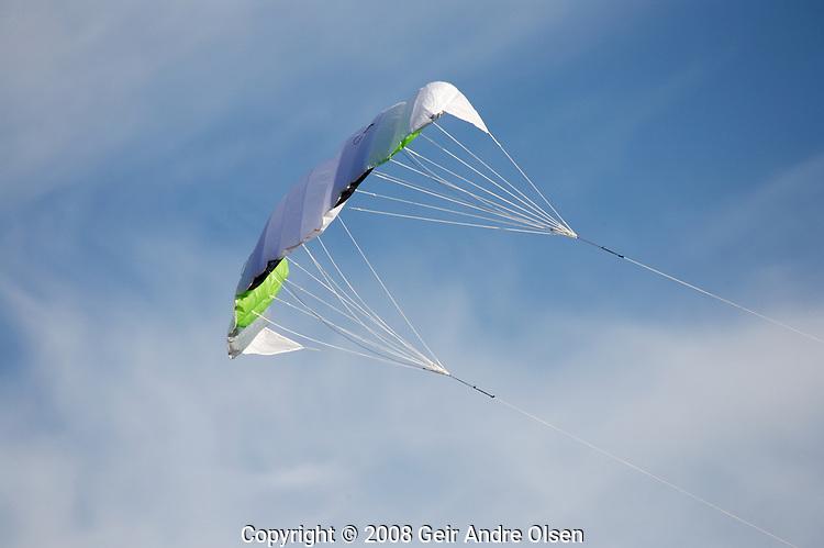 Kite flying high in the blue sky