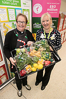 Asda Colleague Samantha Thornton (right) hands over a donation of food to the Rev Samantha Tredwell of St John's Church at Asda's Long Eaton store
