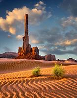 Totem Pole and dunes at sunrise. Monument Valley Arizona