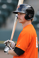 Third baseman Garrett Buechele (21) of the Augusta GreenJackets, a San Francisco Giants affiliate, prior to a game against the Greenville Drive on April 19, 2012, at Fluor Field at the West End in Greenville, South Carolina. (Tom Priddy/Four Seam Images)