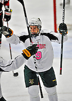 28 January 2012: University of Vermont Catamount forward Kyle Reynolds, a Freshman from Sylvan Lake, Alberta, celebrates a first period goal against the visiting Northeastern University Huskies at Gutterson Fieldhouse in Burlington, Vermont. The Catamounts, dressed in their Breast Cancer Awareness jerseys, fell to the Huskies 4-2 in the second game of their 2-game Hockey East weekend series. Mandatory Credit: Ed Wolfstein Photo