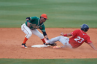 Greensboro Grasshoppers shortstop Marcos Rivera (11) tags Gregori Rivero (23) out on a stolen base attempt during a game against the Lakewood BlueClaws on June 10, 2018 at First National Bank Field in Greensboro, North Carolina.  Lakewood defeated Greensboro 2-0.  (Mike Janes/Four Seam Images)