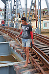 Man With Fish On Railroad Trestle