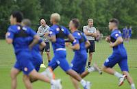 QPR assistants Kevin Bond and Joe Jordan watch the first team train
