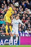 Alex Sandro of Juventus (L) fights for the ball with Luka Modric of Real Madrid (R) during the UEFA Champions League 2017-18 quarter-finals (2nd leg) match between Real Madrid and Juventus at Estadio Santiago Bernabeu on 11 April 2018 in Madrid, Spain. Photo by Diego Souto / Power Sport Images