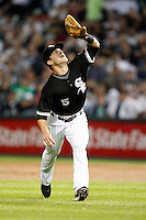 August 7, 2009:  Second Baseman Jayson Nix (5) of the Chicago White Sox catches a fly ball during a game vs. the Cleveland Indians at U.S. Cellular Field in Chicago, IL.  The Indians defeated the White Sox 6-2.  Photo By Mike Janes/Four Seam Images