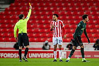 23rd December 2020; Bet365 Stadium, Stoke, Staffordshire, England; English Football League Cup Football, Carabao Cup, Stoke City versus Tottenham Hotspur; Jordan Cousins of Stoke City receives a yellow card for a foul on Dele Alli