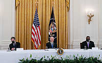 United States President Joe Biden holds a Cabinet Meeting in the East Room of the White House in Washington D.C. on Thursday, April 1, 2021.  President Biden announced that he is asking five cabinet members to explain his jobs plan to the American public.  Pictured from left to right: US Secretary of State Antony Blinken; President Biden; and US Secretary of Defense Lloyd J. Austin III<br /> CAP/MPI/RS<br /> ©RS/MPI/Capital Pictures