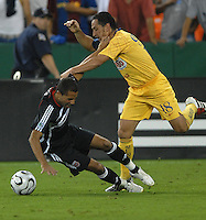 Club America midfielder German Villa (18) fouls DC United midfielder Fred (7). DC United defeated Club America 1-0 to secure one of the two semifinal berths in SuperLiga group B, at RFK Stadium in Washington DC, Sunday July 29, 2007.