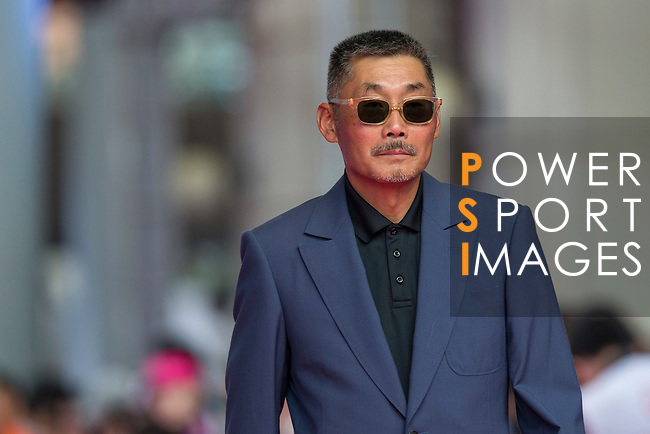Director He Ping (sunglasses) walks the Red Carpet event at the World Celebrity Pro-Am 2016 Mission Hills China Golf Tournament on 20 October 2016, in Haikou, China. Photo by Victor Fraile / Power Sport Images
