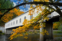 Goodpasrture Bridge over Mckenzie River with fall color. Oregon