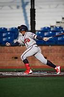 Danville Braves right fielder Henry Quintero (24) follows through on a swing during a game against the Johnson City Cardinals on July 29, 2018 at TVA Credit Union Ballpark in Johnson City, Tennessee.  Johnson City defeated Danville 8-1.  (Mike Janes/Four Seam Images)