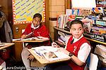 K-8 Parochial School Bronx New York Grade 5 students listening and talking in class horizontal