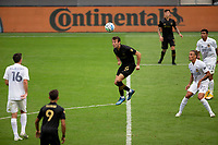 LOS ANGELES, CA - OCTOBER 25: Danny Musovski #16 of the Los Angeles Galaxy heads a ball during a game between Los Angeles Galaxy and Los Angeles FC at Banc of California Stadium on October 25, 2020 in Los Angeles, California.