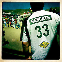 A relative of one of the 33 trapped miners at the mine San Jose in Copiapo, Chile, October 13, 2010, wears a t-shirt that reads Rescue 33, hour before the final rescue...Photo by Roberto Candia