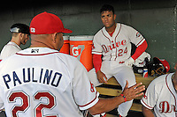 Hitting coach Nelson Paulino (22) of the Greenville Drive talks with second baseman Yoan Moncada (24) in a game against the Lexington Legends on Tuesday, May 19, 2015, at Fluor Field at the West End in Greenville, South Carolina. (Tom Priddy/Four Seam Images)