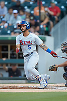 Tim Lopes (5) of the Buffalo Bison follows through on his swing against the Charlotte Knights at BB&T BallPark on August 14, 2018 in Charlotte, North Carolina. The Bison defeated the Knights 14-5.  (Brian Westerholt/Four Seam Images)