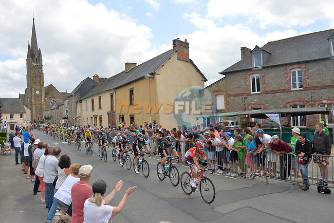The peloton pass through Medreac during Stage 8 of the 2015 Tour de France running 181.5km from Rennes to Mur de Bretagne, France. 10th July 2015.<br /> Photo: ASO/B.Bade/Newsfile