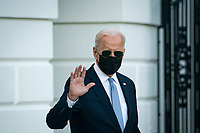 U.S. President Joe Biden waves as he walks on the South Lawn of the White House before boarding Marine One in Washington, D.C., U.S., on Friday, Sept. 24, 2021. Biden and the leaders of Australia, India, and Japan made a show of unity against China today, meeting together at the White House in a first-ever summit to discuss initiatives to counter Beijing's influence across the Pacific. Photographer: Al Drago/Bloomberg<br /> Credit: Al Drago / Pool via CNP /MediaPunch