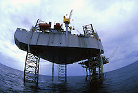 Offshore rig in Gulf of Mexico--production rig with drilling rig adjacent to it. Gulf of Mexico.