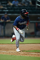 Trey Harris (22) of the Mississippi Braves hustles down the first base line against the Birmingham Barons at Regions Field on August 3, 2021, in Birmingham, Alabama. (Brian Westerholt/Four Seam Images)