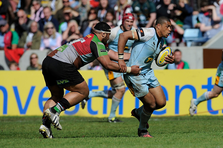 Luther Burrell of Northampton Saints runs through the tackle of James Johnston of Harlequins during the Aviva Premiership match between Harlequins and Northampton Saints at the Twickenham Stoop on Saturday 4th May 2013 (Photo by Rob Munro)