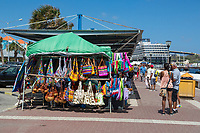 Willemstad, Curacao, Lesser Antilles.  Souvenir Stands on the Cruise Ship Pier, Holland-America Zuiderdam in the Background.