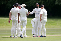 A Malik of Hornchurch celebrates with his team mates after taking the wicket of R Ahmed during Billericay CC (batting) vs Hornchurch CC, Hamro Foundation Essex League Cricket at the Toby Howe Cricket Ground on 12th June 2021