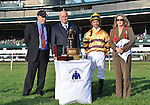 Shadwell Farm President Rick Nichols presents the trophy to trainer Charles Lopresti and jockey Jose Lezcano for Wise Dan's win in the Shadwell Turf Mile at Keeneland Racecourse.October 6, 2012.