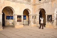 """Paintings of """"Mr. Co"""" (Corentin Faye) on Display in the Former Residence of the French Colonial Governor, Goree Island, Senegal."""